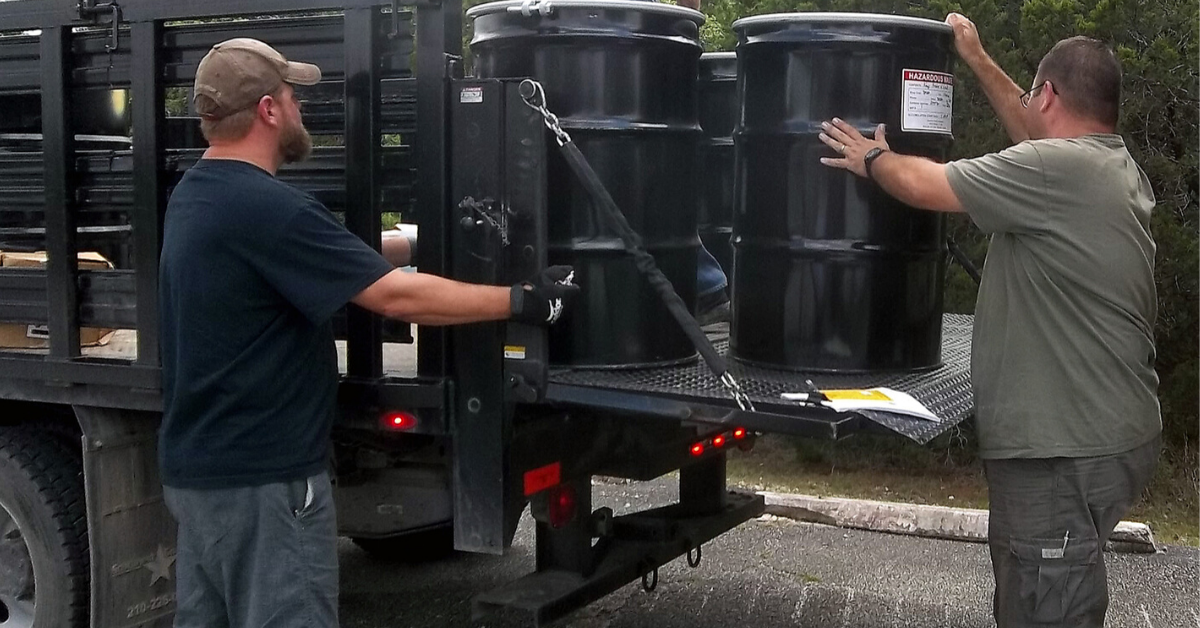 loading hazardous waste onto a truck
